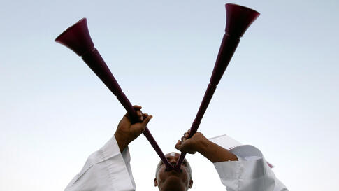 A Qatari soccer fan blows a vuvuzela before the announcement of the hosts for the 2022 World Cup, in Souq Waqif December 2. (Fadi Al-Assaad/Reuters)