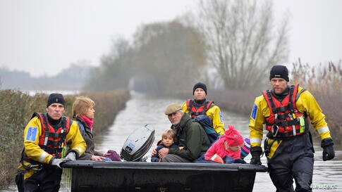 Emergency service personnel rescue local residents from the village of Muchelney on the Somerset Levels, near Langport in south west England. Surrounded by flood water, Muchelney has only been accessible by boat for several weeks.