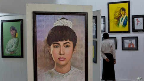 Portraits of Myanmar's pro-democracy leader Aung San Suu Kyi are exhibited at an art gallery in Yangon. A group of Myanmar artists showcase an exhibition of 69 portraits of Aung San Suu Kyi, depicting her life and different moods of the Nobel laureate ...
