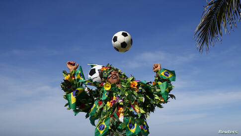 A Brazilian football fan plays with a soccer ball on a beach in Rio de Janeiro. The 2014 World Cup starts in Brazil on June 12, 2014.