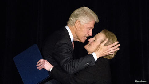 Former U.S. President Bill Clinton greets former Secretary of State Madeleine Albright on stage at the Annual Freedom Award Benefit Event hosted by the International Rescue Committee at the Waldorf-Astoria in New York, Nov. 6, 2013. This year's event h...