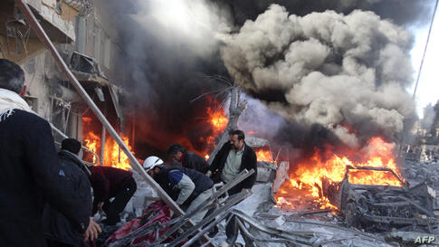 Medical personnel look for survivors following a reported airstrike on the Tariq al-Bab district of the northern Syrian city of Aleppo.