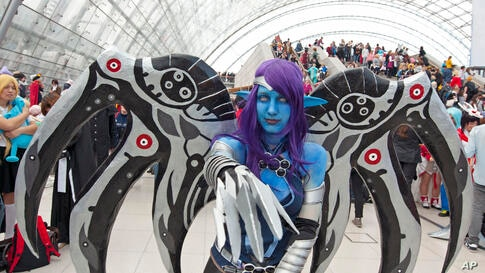 A cosplayer dressed in a fantasy costume performs during the Manga-Comic-Convention at the Leipzig International Book Fair in Leipzig, Germany.