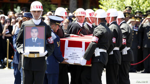 Nihal Ertan, wife of fallen pilot Captain Gokhan Ertan, kisses the coffin of her husband during an official farewell ceremony at the 7th Jet Main Air Base, Malatya, Turkey, July 6, 2012.
