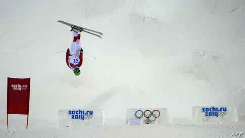 China's Ning Qin competes in the Women's Freestyle Skiing Moguls qualifications at the Rosa Khutor Extreme Park during the Sochi Winter Olympics, Russia.