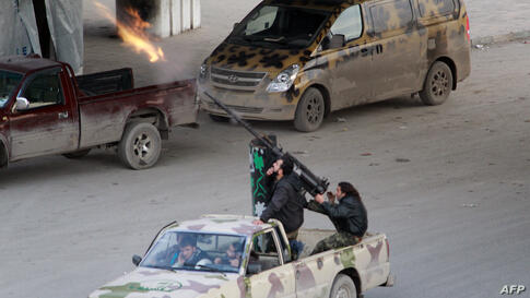 Syrian opposition fighters fire at planes of government forces flying overhead in the northern city of Aleppo.