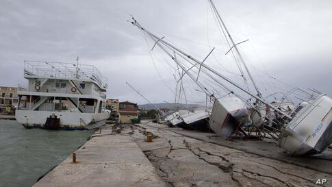 Damage is seen after an earthquake at Lixouri port on the island of Kefalonia, western Greece. The quake with a preliminary magnitude between 5.7 and 6.1 hit the island of before dawn, sending scared residents into the streets just over a week after a ...