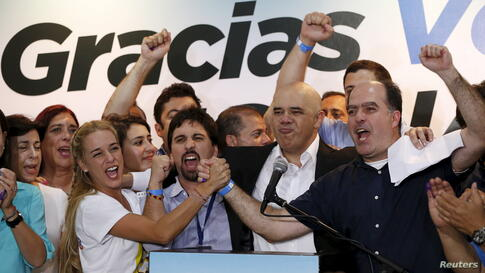 Lilian Tintori (centef L), wife of jailed Venezuelan opposition leader Leopoldo Lopez, celebrates next to candidates of the Venezuelan coalition of opposition parties (MUD) during a news conference on the election in Caracas. Opposition won control of ...