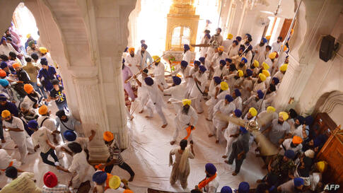 Sikh activists clash with members of the Shiromani Gurudwara Prabhandak Committee during commemorations for the 30th anniversary of Operation Blue Star at the Golden Temple in Amritsar, India. At least two people were wounded after clashes broke out be...