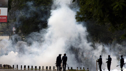 Kenyan police use tear gas to disperse Nairobi University Students, who rioted over the death of two of their colleagues, in Nairobi. The students said they wanted an explanation of how the two engineering students died within a day while in police cus...