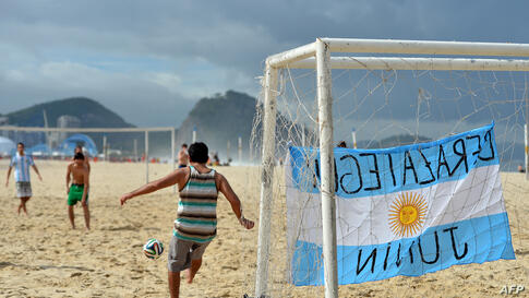 Argentinian fans play football (soccer) on Copacabana beach in Rio de Janeiro, Brazil, two days before the 2014 FIFA World Cup final between Germany and Argentina.