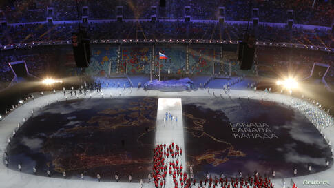 OlympicsA map of Canada is projected onto the stadium floor as athletes march in during the opening ceremony of the 2014 Sochi Winter Olympics, Feb. 7, 2014.
