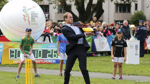 Britain's Prince William hits a ball using a cricket bat while attending a promotional event for the upcoming Cricket World Cup in Christchurch, New Zealand.