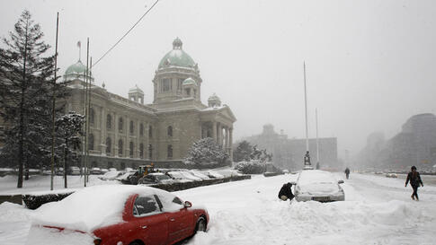 Broken down cars sit in front of the Serbian Parliament building in downtown Belgrade, Serbia, February 3, 2012. (AP)