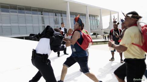 Indians clash with guards during a protest at the Planalto Palace in Brasilia, Brazil, against demarcation of indigenous lands.