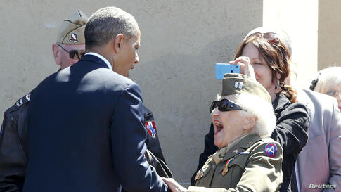 A World War II veteran reacts as she meets U.S. President Barack Obama during the 70th French-American Commemoration D-Day Ceremony at the Normandy American Cemetery and Memorial in Colleville-sur-Mer, France.