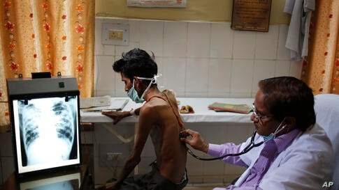 An Indian doctor examines a tuberculosis patient in a government TB hospital on World Tuberculosis Day in Allahabad, India. India has the highest incidence of TB in the world, according to the World Health Organization's Global Tuberculosis Report 2013.