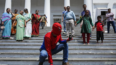 Gaurav Sharma, an independent candidate also known as the Indian Spider Man, arrives to file his nomination for the upcoming general election in Mumbai. India will hold its general election in nine stages staggered between April 7 and May 12.