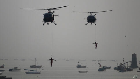 Indian Navy Commandos show their skills during Naval Day celebrations at the Arabian Sea in Mumbai, India. Navy Day is celebrated on Dec. 4.