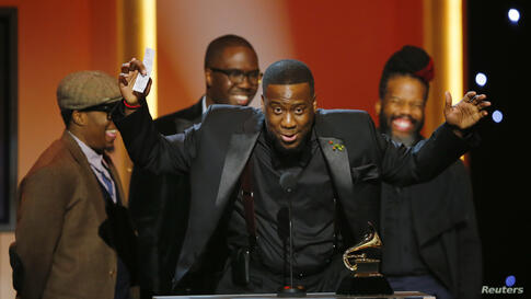 """The Robert Glasper Experiment accept their award for best R&B Album for their album """"Black Radio"""" at the 55th annual Grammy Awards in Los Angeles, California, Feb. 10, 2013."""