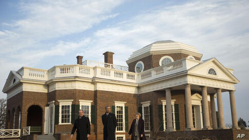 President Barack Obama and French President Francois Hollande tour the grounds of Monticello, President Thomas Jefferson's estate in Charlottesville, Virginia, Feb. 10, 2014.