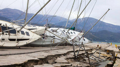 Yachts are seen knocked off their stands at a damaged dock after an earthquake in Lixouri on the island of Kefalonia, western Greece, Feb. 3, 2014. A strong earthquake with a preliminary magnitude between 5.7 and 6.1 hit the western island of Kefalonia...
