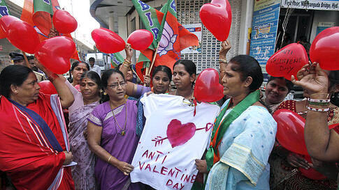 Women activists hold an effigy during a protest against Valentine's Day celebrations in Hyderabad, India, February. 14, 2012. (AP)