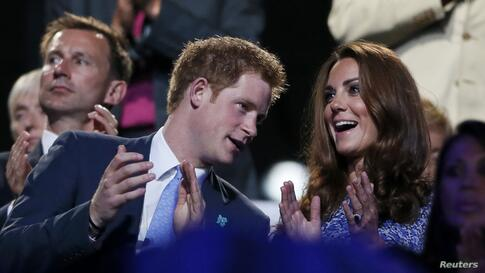 Britain's Prince Harry (L) and Dutchess of Cambridge Kate Middleton (R) applaud as they view the closing ceremony of the London 2012 Olympic Games at the Olympic Stadium August 12, 2012.