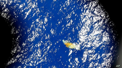 An image taken from a Royal New Zealand P-3 Orion shows a piece of unknown debris floating just under the water while the plane was searching for missing Malaysia Airlines Flight MH370 in the southern Indian Ocean, Australia.