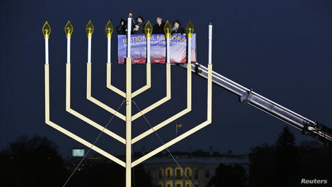 Rabbi Levi Shemtov (2nd L), executive vice president of American Friends of Lubavitch (Chabad), lights the U.S. National Chanukah (Hanukkah) Menorah on the Ellipse in front of the White House, Washington, D.C., with U.S. Trade Representative Michael Fr...