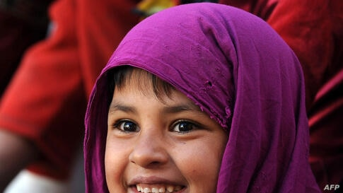 An Afghan child looks on as performers from The Mobile Mini Circus for Children (MMCC) take part in a circus show in Kabul.