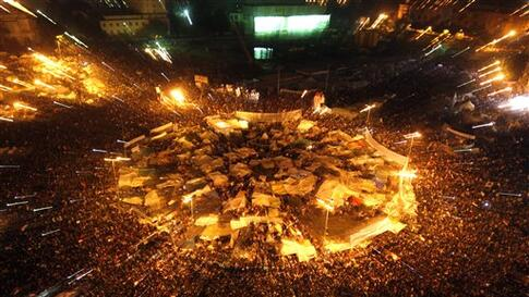 Egyptians celebrate after President Hosni Mubarak resigned and handed power to the military at Tahrir Square, in Cairo, Egypt, Friday, Feb. 11, 2011. Egypt exploded with joy, tears, and relief after pro-democracy protesters brought down President Hosni Mu