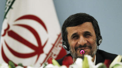 Iranian President Mahmoud Ahmadinejad smiles as he addresses the media during a news conference in Istanbul, Turkey, 24 Dec 2010