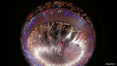 Fireworks are seen through a fish eye lens during the closing ceremony of the London 2012 Olympic Games at the Olympic Stadium, August 12, 2012.