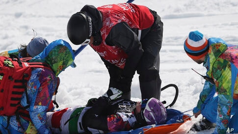Italy's Michela Moioli is placed on a stretcher after a crash in the women's snowboard final at the Rosa Khutor Extreme Park, in Krasnaya Polyana, Russia, Feb. 16, 2014.
