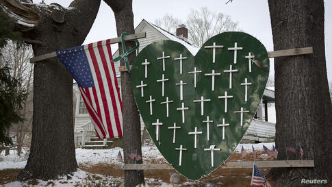 A heart is emblazoned with crosses to commemorate the 26 Sandy Hook Elementary School shooting victims in Newtown, Connecticut. December 14th marks the one-year anniversary of the shooting rampage by a lone gunman.