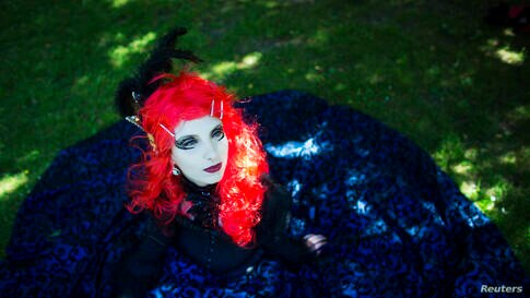 A reveler poses for pictures at the Victorian Picnic during the Wave and Goth festival in Leipzig, Germany. The annual festival, known in Germany as Wave-Gotik Treffen (WGT), features over 150 bands and artist in venues all over the city playing Gothic...