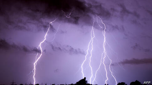Lightning over Algermissen, Germany. Violent storms killed at least six people in western Germany overnight, felling trees and snarling road and rail traffic, authorities said.