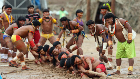 Members of the Brazilian Enawene-Awe indigenous ethnic group compete in a tug-of-war competition at the XII Games of the Indigenous People, in Cuiaba.