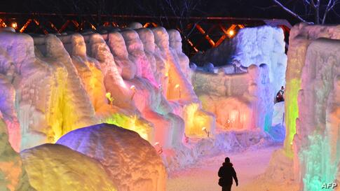 People visit the Chitose-Lake Shikotsu Ice Festival illuminated by colorful light to produce a fantastic world in Chitose, Japan, Jan. 24, 2014.