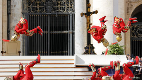 Acrobats perform at the end of Pope Francis general audience in Saint Peter's square at the Vatican.