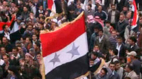 A still image taken from amateur video purportedly shows anti-government demonstrators rallying in Jasim, Deraa Governorate, April 22, 2011