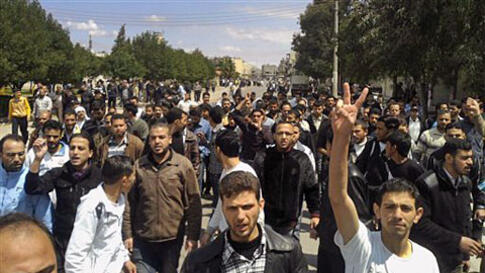 Syrian anti-government protesters demonstrate following Friday prayers in the central city of Homs, Apr 22 2011