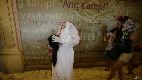 """Children dressed in their most scariest costumes make the rounds of stalls at Manila's Ocean Park, the country's largest oceanarium, for free candies, chocolates and sweets, as they take part in the annual Halloween """"Trick or Treat"""" activity ahead of n..."""
