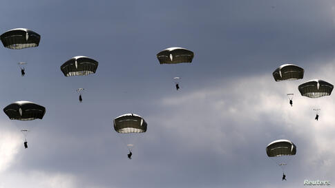 "Troops from the U.S. Army's 173rd Infantry Brigade Combat Team parachute during a NATO-led exercise ""Orzel Alert"" (Eagle Alert) held together with Canada's 3rd Battalion and Princess Patricia's Light Infantry, and Poland's 6th Airborne Brigade in Bledo..."