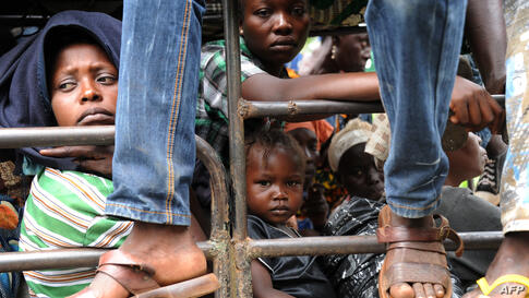 Residents of the city of Damara, 75 km north of Bangui, leave the region for Bangui, Central African Republic, as French forces deploy in a bid to halt spiralling violence.