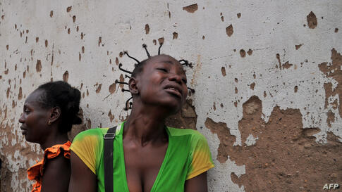 Two women mourn the death of two relatives killed in the 5th district, one the of the city's central neighborhoods, in Bangui, Central African Republic. The International Criminal Court in the Hague said on February 7 it had opened an initial probe int...