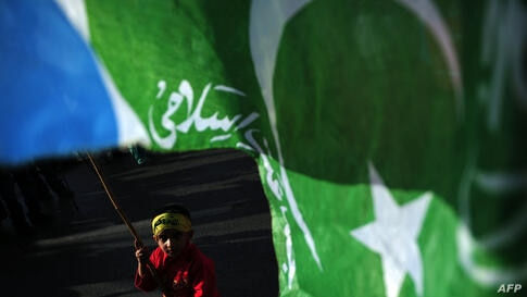 A Pakistani child waves a flag of the fundamentalist Islamic political party Jamaat-i-Islami (JI) during the Kashmir Solidarity Day rally in Karachi. Hundreds of people rallied across Pakistan to denounce Indian rule in Kashmir, the disputed Muslim-maj...