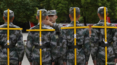 New recruits of the Chinese People's Liberation Army take part in training to adjust their standing postures in Hangzhou, Zhejiang province.