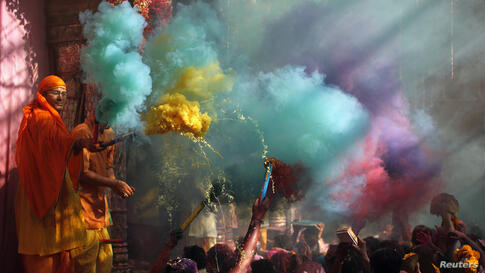 Hindu priests throws colored powder at the devotees during Holi celebrations at Bankey Bihari temple in Vrindavan, in the northern Indian state of Uttar Pradesh. Holi, also known as the Festival of Colors, heralds the beginning of spring and is celebra...